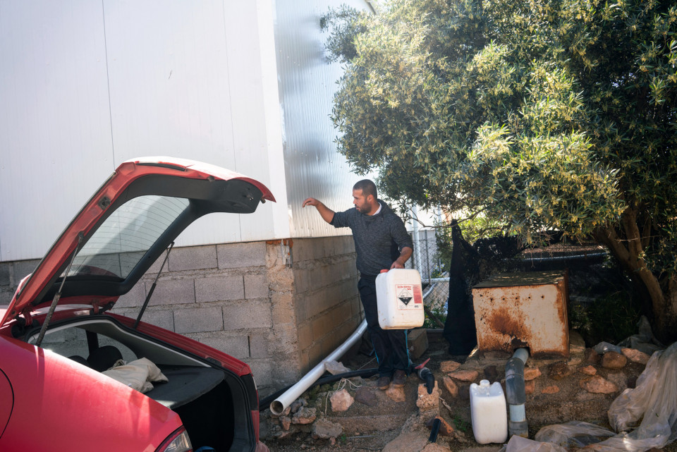 A Moroccan worker living in the ghetto stealing water, Spain,