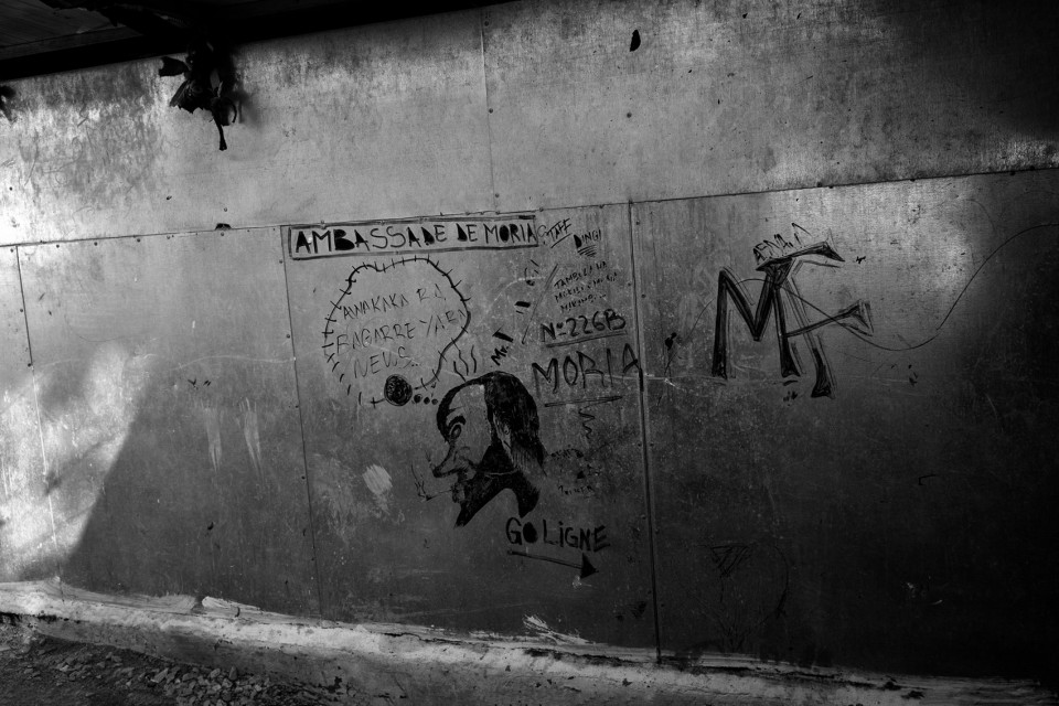 Graffiti at the back of showers inside the refugee camp Moria, Lesvos, Greece