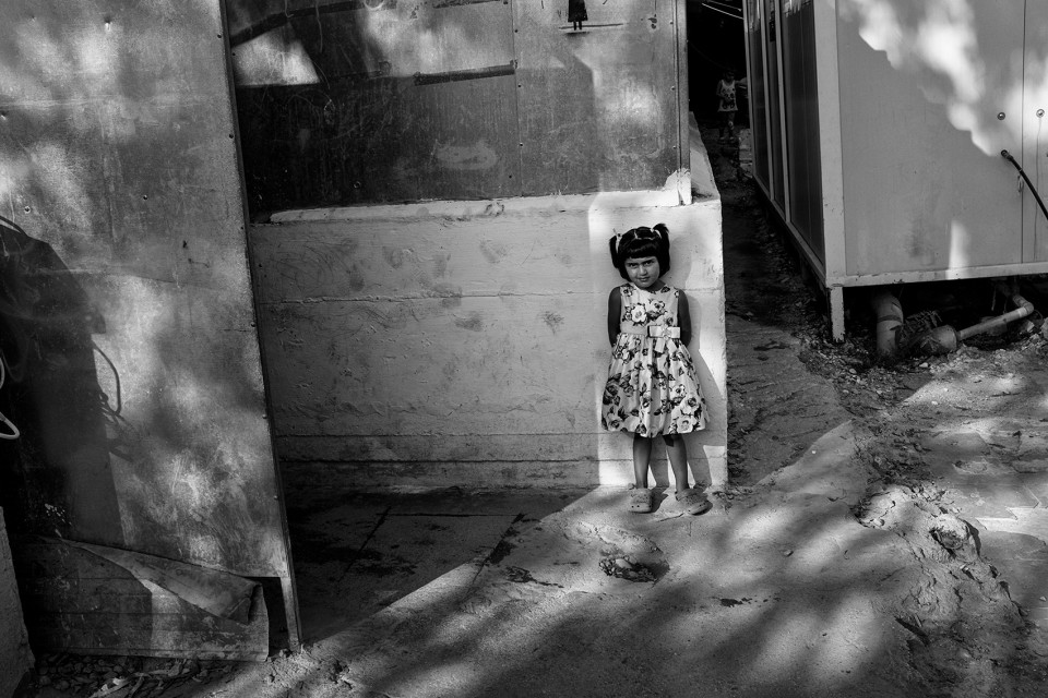A girl inside the refugee camp Moria, Lesbos, Greece