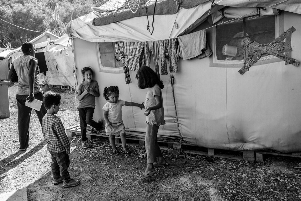 Children inside the refugee camp Moria, Lesbos, Greece
